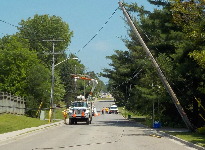 Power restored but road still closed following truck crash
